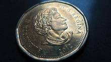 A Canadian dollar or loonie. (Jonathan Hayward/THE CANADIAN PRESS)