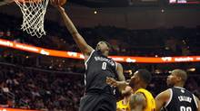 Apr 12, 2014; Cleveland, OH, USA; Brooklyn Nets center Andray Blatche (0) drives to the basket in the first quarter against the Cleveland Cavaliers at Quicken Loans Arena. (David Richard/USA Today Sports)