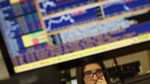 A trader watches the screens at a bank's trading room in Lisbon February 20, 2013. (RAFAEL MARCHANTE/REUTERS)