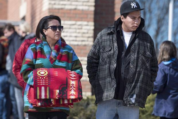Debbie Baptiste, mother of Colten Boushie, and her son Jace Baptiste leave the provincial court during a stoppage in proceedings during the first day of preliminary hearing investigating the murder of Boushie, in North Battleford, Sask. April 3.