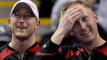 Canada skip Brad Jacobs, right, and lead Ryan Harnden share a laugh during a morning draw against Finland at the World Men's Curling Championship in Victoria, B.C. Sunday, March 31, 2013. (JONATHAN HAYWARD/THE CANADIAN PRESS)