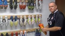 Equipment manager Malcolm Phillips shows off the Toronto FC boot room in Toronto, Sept.28, 2012. Even in an otherwise drab season for Toronto FC, there has been a splash of colour. It's in the MLS team's boot room. (Neil Davidson/THE CANADIAN PRESS)