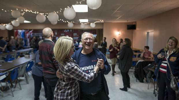 Appleton mayor Derm Flynn, one of the Newfoundlanders portrayed in Come From Away, laughs as he dances with cast member Kendra Kassebaum at an after-show celebration on Oct. 30.