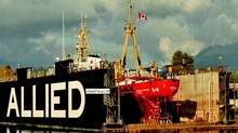 "The Canadian Coast Guard ship ""Tanu"" in Allied Shipbuilders' floating drydock. (COURTESY OF ALLIED SHIPBUILDERS)"