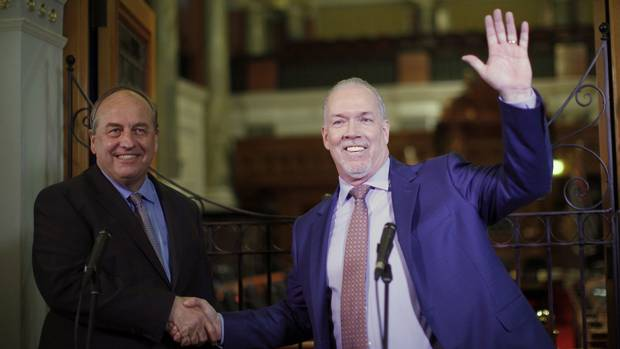 B.C. Green Party Leader Andrew Weaver and B.C. NDP Leader John Horgan speak to media in Victoria on May 29, 2017, after announcing they'll be working together to help form a minority government.