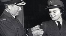 Jackie Willis-O'Connor receives her Wireless Sparks badge from her father, First World War flying ace Billy Bishop.