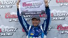 Driver Alex Tagliani reacts after taking the pole position for NAPA Auto Parts 200 Nationwide Series NASCAR race in Montreal, August 17, 2012. (Olivier Jean/Reuters)