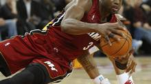 Miami Heats' Dwyane Wade looks to pass from the floor during the first half of an NBA basketball game against the Golden State Warriors Wednesday, Jan. 13, 2010, in Oakland, Calif. (AP Photo/Ben Margot) (Ben Margot)