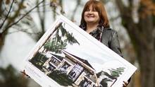 Gay Klietzke, executive director of the Vancouver Hospice Society, holds the plan of the new hospice she is trying to raise money for. (John Lehmann/The Globe and Mail)