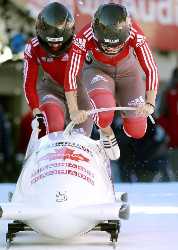 Canada's pilot Kaillie Humphries (R) and brakewoman Chelsea Valois start on the natural ice track during the first run of the two-women competition at the FIBT Bobsleigh and Skeleton World Championships 2013 on Jan. 25, 2013.