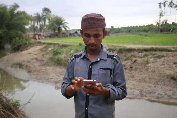 Mohammad Faisal stands near the spot in Anzuman Para, Bangladesh, where he first arrived after fleeing violence in his Myanmar village.