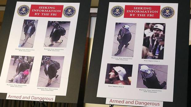 Photos of suspects in the Boston Marathon bombings are seen during a news conference in Boston, Massachusetts April 18, 2013. (SHANNON STAPLETON/Reuters)