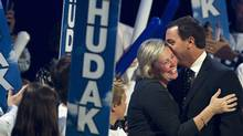 Ontario Progressive Conservative leader Tim Hudak, right, and his wife Deb Hutton share a moment on stage at his campaign headquarters in Niagara Falls, Ont., on Thursday, Oct. 6, 2011. (Nathan Denette/The Canadian Press)