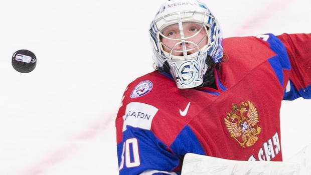 Russia goalie Andrei Vasilevski eyes the puck while playing aganist Switzerland during first period quarter-final IIHF World Junior Championships hockey action in Ufa, Russia on Wednesday, Jan. 2, 2013. (Nathan Denette/THE CANADIAN PRESS)
