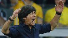 Germany's coach Joachim Loew celebrates his team's fifth goal against Brazil during their 2014 World Cup semi-finals at the Mineirao stadium in Belo Horizonte July 8, 2014. (Reuters)