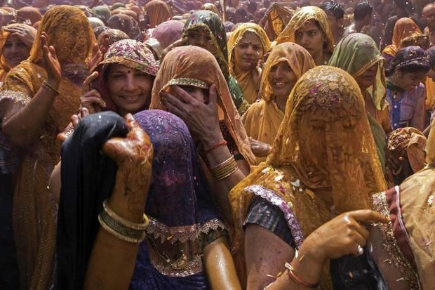 Hindi women participate in the Holi festival.