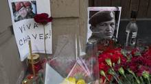 Candles, flowers and traditional Russian bottle of vodka, placed next to an image of Venzuela's late President Hugo Chavez outside the Venezuela's embassy in Moscow on Wednesday, March 6, 2013. Venezuela's Vice President Nicolas Maduro announced that Chavez died on Tuesday at age 58 after a nearly two-year bout with cancer. (Misha Japaridze/AP)