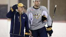 FILE - In this Sept. 13, 2013, file photo, Nashville Predators head coach Barry Trotz talks with defenseman and team captain Shea Weber, right, during an NHL hockey training camp in Nashville, Tenn. (Mark Humphrey/AP)