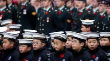 Navy cadets stand in formation in front of members of the Canadian Forces during a Remembrance Day ceremony in Vancouver in 2012. (DARRYL DYCK/THE CANADIAN PRESS)