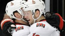 Ottawa Senators' Jason Spezza (19) celebrates his empty-net goal with Zenon Konopka during the third period of Game 5 of an NHL Stanley Cup first-round hockey playoff series against the New York Rangers, Saturday, April 21, 2012, at New York's Madison Square Garden. The Senators won 2-0 to lead the series 3-2. (AP Photo/Bill Kostroun) (Bill Kostroun)