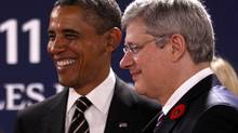 Canada's Prime Minister Stephen Harper (R) and U.S. President Barack Obama (L) discuss while awaiting the start of a meeting on the second day of the G20 Summit in Cannes November 4, 2011. (KEVIN LAMARQUE/REUTERS)