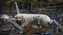 A Boeing 787 sits on the assembly line at the plant in Everett, Wash. Boeing is racing to turn a record backlog of more than 4,000 orders into revenue and profit. (ANDY CLARK/REUTERS)