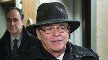 Former Quebec Federation of Labour president Michel Arsenault arrives at the Charbonneau Commission looking into corruption in the Quebec construction industry Monday, January 27, 2014 in Montreal. (PAUL CHIASSON/THE CANADIAN PRESS)