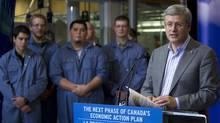 Prime Minister Stephen Harper addresses a gathering as he opens new facilities at the Northern Lights College in Dawson Creek, B.C., Saturday, Oct. 15, 2011. (JONATHAN HAYWARD/Jonathan Hayward/The Canadian Press)