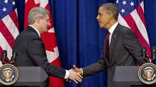 Prime Minister Stephen Harper shakes hands with U.S. President Barack Obama after a joint news conference in Washington on Feb. 4, 2011. (Sean Kilpatrick/Sean Kilpatrick/The Canadian Press)