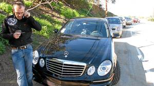 Felix Filhop of the X-17 Photo agency staked out with his AMG Mercedes on Mulholland Drive in Los Angeles, near the homes of actress Mischa Barton and pop star Britney Spears.