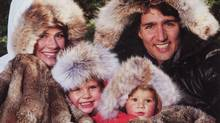 Liberal MP Justin Trudeau poses with his family on his annual Christmas card wearing a fur parka. (Adrian Wyld/Adrian Wyld / Canadian Press)