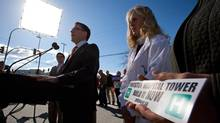Dr. Susan Tebbutt, right, listens as B.C. NDP Leader Adrian Dix speaks during a campaign stop across the street from Penticton Regional Hospital in Penticton, B.C., on May 3, 2013. (Darryl Dyck/The Canadian Press)
