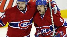 Montreal Canadiens' Tom Kostopoulos celebrates with Guillaume Latendresse after scoring the fourth goal against the Boston Bruins during third period of game one NHL Stanley Cup first round hockey playoff action in Montreal , Thursday April 10, 2008. (Ryan Remiorz/THE CANADIAN PRESS)