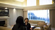 Realtor Edith Chan, right, shows Jin Wang, a potential buyer from China, a house on the market worth more than $3-million in West Vancouver. (Rafal Gerszak/Rafal Gerszak for The Globe and)