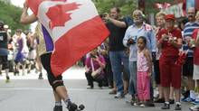 Visible minorities formed the majority of Montreal's Canada Day crowd. They also fuelled the procession, with marching bands (Jamaican), dance troupes (Indian, Iraqi, among many others) and a Chinese dragon (Graham Hughes/THE CANADIAN PRESS)