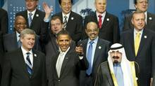 Leaders wave during a group photo at the G20 summit in Toronto June 27, 2010. (DON EMMERT/DON EMMERT/AFP/Getty Images)