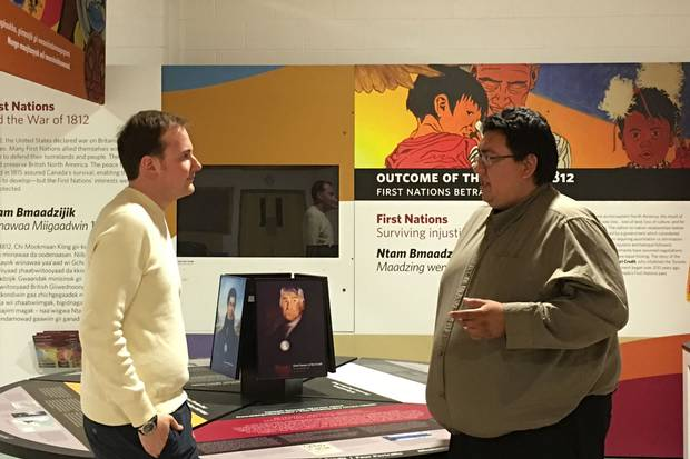 Charlie Sault speaks with Josh Hellyer at the Mississaugas of the New Credit Interpretive Centre. Mr. Sault works as a community liaison between Indigenous communities and businesses to match youth with potential employers.