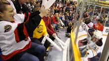 Fans react to a hit in the corner during the first period of the game between the Ottawa Senators and the Buffalo Sabres inside the JL Grightmie Arena in Dundas, Ontario - Kraft Hockeyville for 2010, on Tuesday, September 28, 2010. (Peter Power/The Globe and Mail)