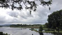A man looks out over the water outside the press center near the venue of the G8 summit in Enniskillen, Northern Ireland, Monday, June 17, 2013. (Lefteris Pitarakis/AP)