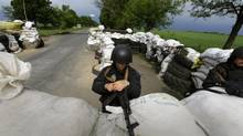 A Ukrainian Interior Ministry officer mans a checkpoint outside the eastern Ukrainian village of Bylbasivka May 14, 2014. (YANNIS BEHRAKIS/REUTERS)
