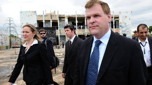 Minister of Foreign Affairs John Baird, right, and Canadian Ambassador to Libya Sandra McCardell, left, visit the former fortified compound of Moammar Gadhafi in Bab al-Azizya in Tripoli, Libya on Tuesday, October 11, 2011.
