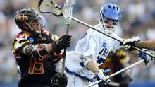 Maryland's Joe Cummings, left, passes the ball as Duke's Henry Lobb, right, defends during the second quarter of their semifinal game in the NCAA Division I college men's lacrosse championship at Gillette Stadium in Foxborough, Mass., Saturday, May 26. (Gretchen Ertl/AP)