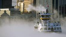 A Metro Transit ferry crosses the harbour through sea smoke, formed when very cold air moves over warm water, in Halifax on Thursday, Jan. 2, 2014. The region is in the grip of unseasonably cold temperatures and the forecast is for blizzard conditions. (Andrew Vaughan/THE CANADIAN PRESS)