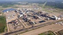A Nexen oil sands facility near Fort McMurray, Alta., is seen in this aerial photograph on July 10, 2012. (Jeff McIntosh/The Canadian Press)