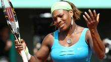 USA's Serena Williams reacts as she plays Australia's Samantha Stosur during their quarterfinal match for the French Open tennis tournament at the Roland Garros stadium in Paris, Wednesday, June 2, 2010. (Lionel Cironneau/AP)