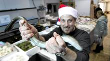 Paul Lionetti grabs hold of a slippery eel at San Antonio Fish Market in Woodbridge, Ont. (Peter Power/The Globe and Mail)