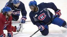 Montreal defenceman P.K. Subban, right, has a laugh with David Desharnais during the team's practice Monday, May 5, 2014, in Brossard, Que. The Canadiens play the Boston Bruins in game three of round two of the Stanley Cup Playoffs Tuesday in Montreal. THE CANADIAN PRESS/Ryan Remiorz (Ryan Remiorz/THE CANADIAN PRESS)