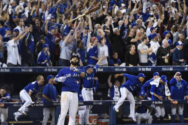 Blue Jays outfielder Jose Bautista flips his bat into the air after hitting a three-run homer in the seventh inning against the Texas Rangers in Game 5 of the American League Division Series on Oct. 14, 2015 in Toronto.