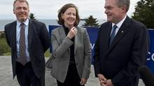 Alison Redford stands beside New Brunswick Premier David Alward on June 7, 2013, on a tour of the Irving Canaport Marine Terminal in Saint John. The proposed Energy East pipeline would take Alberta's oil as far as Saint John, but Quebec has been a vocal critic of the plan. (ANDREW VAUGHAN/THE CANADIAN PRESS)