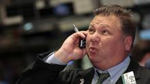 A trader reacts while working on the floor of the New York Stock Exchange on Monday. (BRENDAN MCDERMID/REUTERS)